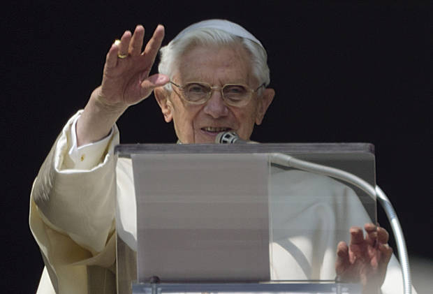 FILE - In this Feb. 17, 2013 file photo, Pope Benedict XVI acknowledges a cheering crowd of faithful and pilgrims during his second-last Angelus prayer from the window of his apartments at the Vatican. As the first pontiff in six centuries to step down, Benedict has carved a new path for his successors who decide they cannot rule for life. But scholars say the repercussions could reach beyond just changing how pontiffs leave to ultimately shape perceptions about the authority and significance of the pontificate.  (AP Photo/Domenico Stinellis)