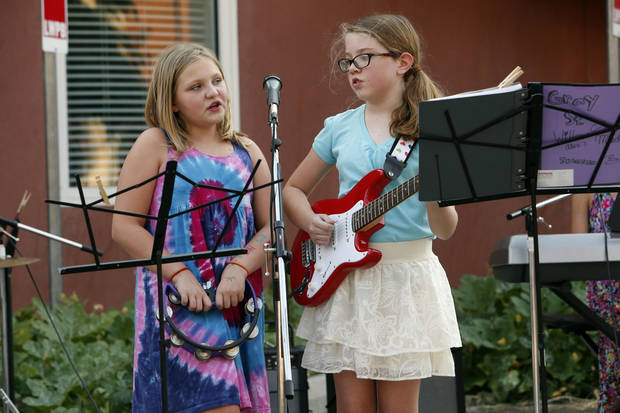 Johanna Bales, left, and Alex Elmore with the Gray Street Band perform at the Kid's Corner Friday as part of the Second Friday Circuit of Art event in Norman. PHOTO BY STEVE SISNEY, THE OKLAHOMAN <strong>STEVE SISNEY</strong>