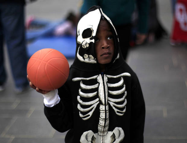 Xavier Scott, 5, plays basketball during the YMCA 5210 event at Myriad Gardens in Oklahoma City. Photo by Sarah Phipps, The Oklahoman <strong>SARAH PHIPPS - SARAH PHIPPS</strong>