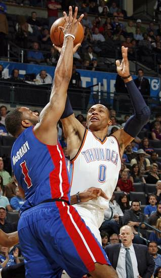 Oklahoma City's Russell Westbrook (0) tries to get a shot past Tracy McGrady (1) of Detroit during an NBA basketball game between the Oklahoma  City Thunder and the Detroit Pistons at the OKC Arena in Oklahoma City, Friday, March 11, 2011. Photo by Nate Billings, The Oklahoman