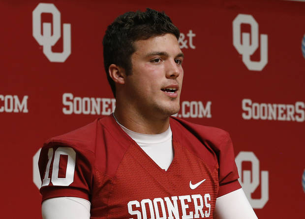Oklahoma quarterback Blake Bell answers a question at a news conference during media day in Norman, Okla., Saturday, Aug. 3, 2013. (AP Photo/Sue Ogrocki)