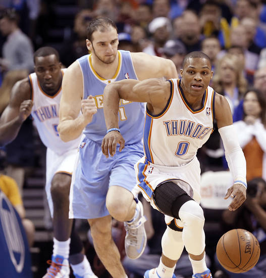 Oklahoma City's Russell Westbrook (0) takes off with the steal on Denver's Kosta Koufos (41) during the NBA basketball game between the Oklahoma City Thunder and the Denver Nuggets at the Chesapeake Energy Arena on Wednesday, Jan. 16, 2013, in Oklahoma City, Okla.  Photo by Chris Landsberger, The Oklahoman