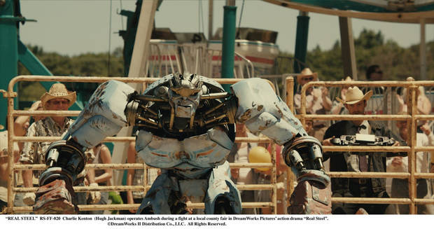 """REAL STEEL""  RS-FF-020  Charlie Kenton  (Hugh Jackman) operates Ambush during a fight at a local county fair in DreamWorks Pictures' action drama ""Real Steel"".  ©DreamWorks II Distribution Co., LLC.  All Rights Reserved."