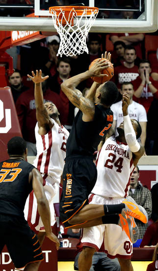 Cowboy's Le'Bryan Nash (2) shots over the arms of Sooner's Amath M'Baye (22) and Sooner's Romero Osby (24) during the second half as the University of Oklahoma Sooners (OU) defeat  the Oklahoma State Cowboys (OSU) 77-68  in NCAA, men's college basketball at The Lloyd Noble Center on Saturday, Jan. 12, 2013  in Norman, Okla. Photo by Steve Sisney, The Oklahoman