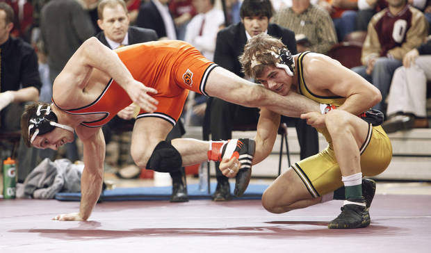 Oklahoma State's Clayton Foster, left, escapes on his way to beating Missouri's Max Askren at 184 pounds on Saturday. Photo by Steve Sisney, The Oklahoman