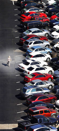 Photo Illustration: Shopper in the mall parking lot at Penn Square Mall in Oklahoma City Wednesday, Oct. 3, 2012.  Photo Illustration by Paul B. Southerland, The Oklahoman