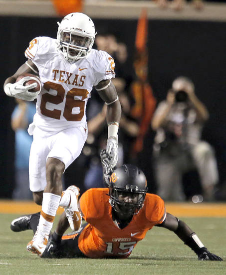 Texas' D.J. Monroe (26) returns a kickoff for touchdown as Oklahoma State's John Goodlett (15) misses a tackle game between Oklahoma State University (OSU) and the University of Texas (UT) at Boone Pickens Stadium in Stillwater, Okla., Saturday, Sept. 29, 2012. Photo by Sarah Phipps, The Oklahoman