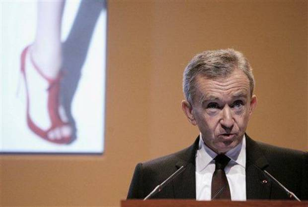 FILE - In this Feb. 5, 2009 file photo, Bernard Arnault, Chairman and CEO of LVMH Moet Hennessy Louis Vuitton, the Paris-based luxury goods empire, presents the group's 2008 results in Paris. T (AP Photo/Michel Euler, File)