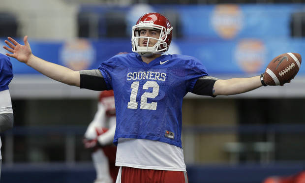Oklahoma quarterback Landry Jones holds a football during practice after media day for Friday's Cotton Bowl NCAA college football game against Texas A&M, at Cowboys Stadium, Sunday, Dec. 30, 2012, in Arlington, Texas. (AP Photo/LM Otero) ORG XMIT: TXMO112