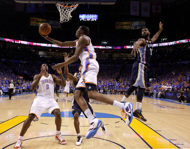 Oklahoma City&#039;s Kevin Durant (35) shoots as O.J. Mayo (32) of Memphis defends during game 7 of the NBA basketball Western Conference semifinals between the Memphis Grizzlies and the Oklahoma City Thunder at the OKC Arena in Oklahoma City, Sunday, May 15, 2011. Photo by Sarah Phipps, The Oklahoman