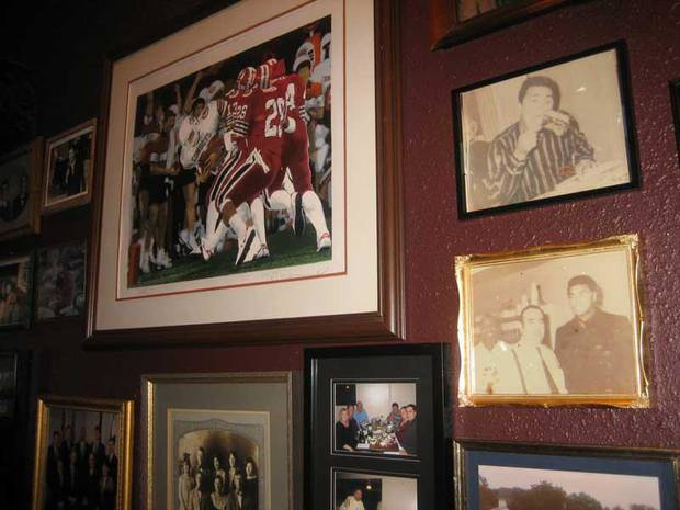 Décor at Jamil's of Tulsa includes college sports and historical photos, including some of stars like Muhammed Ali who have enjoyed Jamil's cuisine.