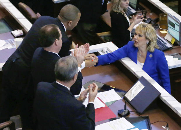 Oklahoma Gov. Mary Fallin, right, shakes hands with Oklahoma House Speaker T.W. Shannon, left, R-Lawton, Lt. Gov. Todd Lamb, center, and President Pro Tem of the Oklahoma Senate Brian Bingman, right, R-Sapulpa, following her State of the State address in Oklahoma City, Monday, Feb. 4, 2013. (AP Photo/Sue Ogrocki) ORG XMIT: OKSO105