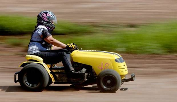 Jessica Shatto races during the El Reno Grascar Association lawn mower race in El Reno, Saturday, June 6, 2009. Photo by Bryan Terry, The Oklahoman