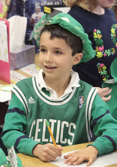 First-grader Will Leonard wears a hat  he made from newspaper, painted green and adorned with a coin for luck  at Christ the King Elementary School to celebrate  St. Patrick's Day, Friday, March 16, 2012.  Photo By David McDaniel/The Oklahoman