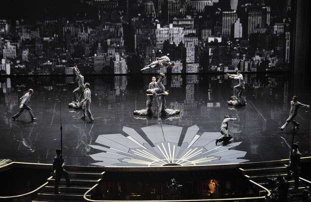 "Members of Cirque du Soleils ""Iris"" perform onstage during the 84th Academy Awards on Sunday, Feb. 26, 2012, in the Hollywood section of Los Angeles. (AP Photo/Mark J. Terrill) ORG XMIT: SHO307"