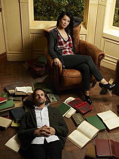 Jonny Lee Miller (left) stars as Sherlock Holmes and Lucy Liu (right) stars as Watson on the new television series ELEMENTARY, premiering Thursdays, 10pm ET/PT this Fall on the CBS Television Network. Photo: Nino Muñoz/CBS©2012 CBS Broadcasting Inc. All Rights Reserved.