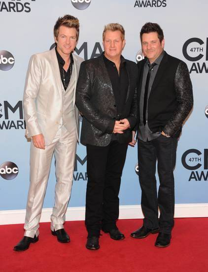 Rascal Flatts, from left, Joe Don Rooney, Gary LeVox, and Jay DeMarcus arrive at the 47th annual CMA Awards at Bridgestone Arena on Wednesday, Nov. 6, 2013, in Nashville, Tenn. (AP file)