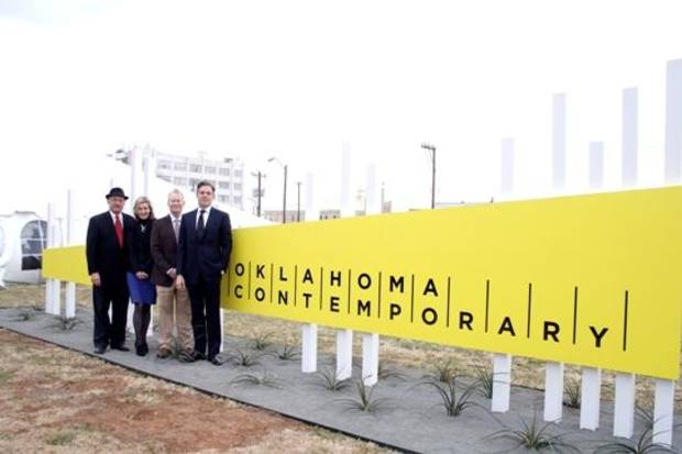 From left, James Pickel, Mary Ann Prior, Mayor Mick Cornett and Christian Keesee pose with the new signage for Oklahoma Contemporary Arts Center.