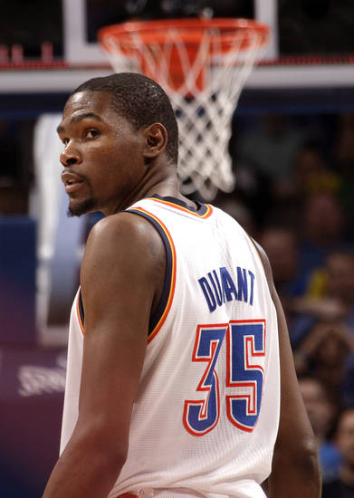 Oklahoma City's Kevin Durant (35)  walks off the court following the Thunder's loss to the Rockets at the Chesapeake Energy Arena, Tuesday, March 13, 2012. Photo by Sarah Phipps, The Oklahoman.
