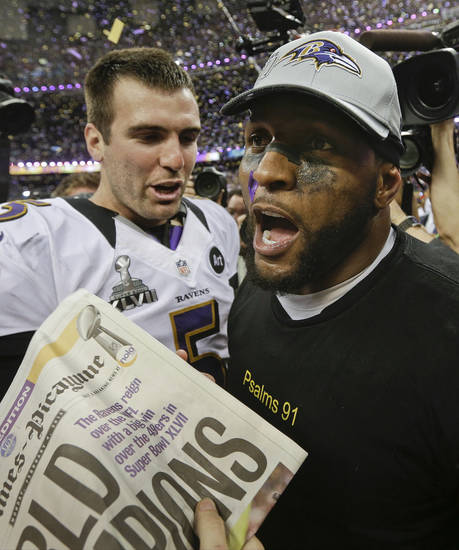 Baltimore Ravens quarterback Joe Flacco (5)  and linebacker Ray Lewis celebrate after defeating the San Francisco 49ers 34-31 in the NFL Super Bowl XLVII football game, Sunday, Feb. 3, 2013, in New Orleans. (AP Photo/Patrick Semansky)