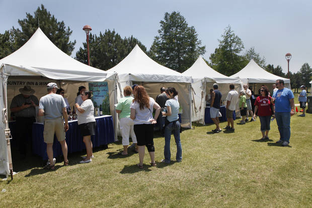Wineries display their products and provide taste samples for visitors in these tents at the Made in Oklahoma Festival held inside and on the grounds of the Reed Conference Center at the Sheraton Midwest City Hotel Saturday afternoon, May, 19, 2012. Photo by Jim Beckel, The Oklahoman