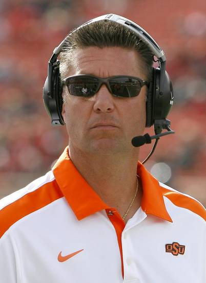 Head coach Mike Gundy walks the sidelines during a college football game between Texas Tech University (TTU) and Oklahoma State University (OSU) at Jones AT&T Stadium in Lubbock, Texas, Saturday, Nov. 12, 2011.  Photo by Sarah Phipps, The Oklahoman  ORG XMIT: KOD