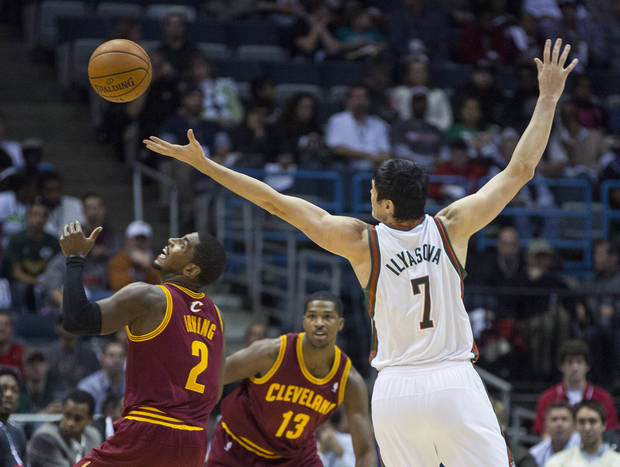 The Milwaukee Bucks' Ersan Ilyasova can't get a hold on the ball and Cleveland Cavaliers' Kyrie Irving comes up with it during the first half of an NBA basketball game, Saturday Nov. 3, 2012 in Milwaukee. (AP Photo/Tom Lynn)