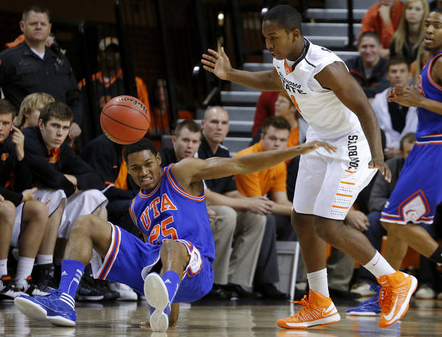 /tut25n/ loses control of the ball beside Oklahoma State's Kirby Gardner (1) during a college basketball game between Oklahoma State University and UT Arlington at Gallagher-Iba Arena in Stillwater, Okla., Wednesday, Dec. 19, 2012. Photo by Bryan Terry, The Oklahoman