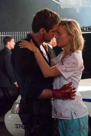 "Gerard Butler, left, and Radha Mitchell in a scene from ""Olympus Has Fallen.""  FILMDISTRICT PHOTO <strong>Phil Caruso</strong>"