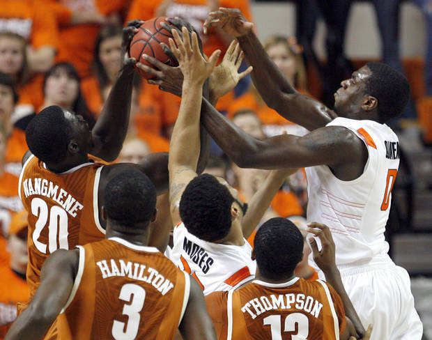 Oklahoma State's Marshall Moses (33) and Oklahoma State's Jean-Paul Olukemi (0) fight Texas' Alexis Wangmene (20), Jordan Hamilton (3) and Tristan Thompson (13) for a rebound during the basketball game between Oklahoma State and Texas, Wednesday, Jan. 26, 2011, at Gallagher-Iba Arena in Stillwater, Okla. Photo by Sarah Phipps, The Oklahoman ORG XMIT: KOD