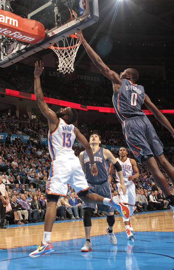 Charlotte Bobcats' Bismack Biyombo (0) is charged with goad tending on a shot by Oklahoma City Thunder's James Harden (13) during the NBA basketball game between the Oklahoma City Thunder and the Charlotte Bobcats at Chesapeake Energy Arena in Oklahoma City, Saturday, March 10, 2012. Photo by Steve Sisney, The Oklahoman
