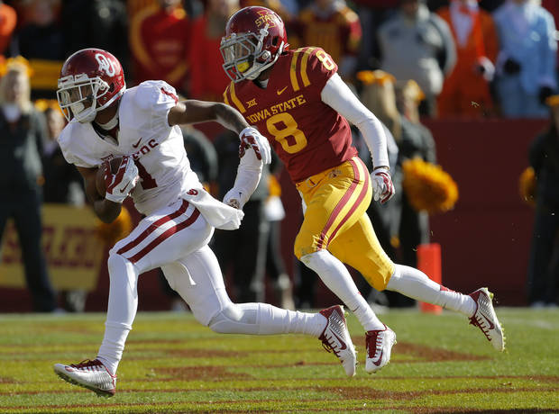 Oklahoma's K.J. Young (1) scores a touchdown past Iowa State's Kenneth Lynn (8) during a college football game between the University of Oklahoma Sooners (OU) and the Iowa State Cyclones (ISU) at Jack Trice Stadium in Ames, Iowa, Saturday, Nov. 1, 2014. Photo by Bryan Terry, The Oklahoman