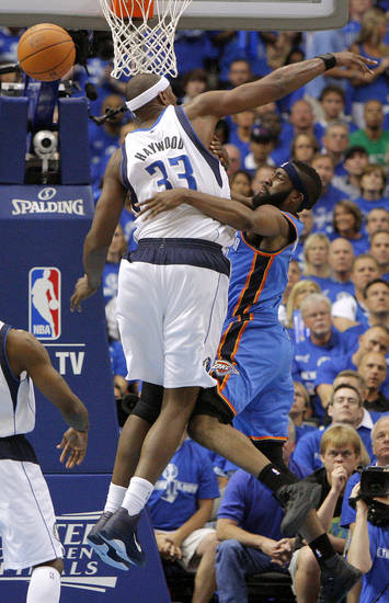 Oklahoma City's James Harden (13) tries to pass the ball around Brendan Haywood (33) of Dallas during game 1 of the Western Conference Finals in the NBA basketball playoffs between the Dallas Mavericks and the Oklahoma City Thunder at American Airlines Center in Dallas, Tuesday, May 17, 2011. Photo by Bryan Terry, The Oklahoman