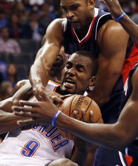 Atlanta Hawk's Al Horford (15) comes over the back of Oklahoma City Thunder's Serge Ibaka (9) as the Atlanta Hawks defeat the Oklahoma City Thunder 104-95 in NBA basketball at the Chesapeake Energy Arena in Oklahoma City, on Sunday, Nov. 4, 2012.  Photo by Steve Sisney, The Oklahoman