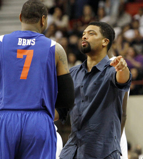White Team Coach Deray Davis talks with Carmelo Anthony during the US Fleet Tracking Basketball Invitational at the Cox Convention Center in Oklahoma City Sunday, Oct. 23, 2011. The White Team defeated the Blue Team 176-171. Photo by John Clanton, The Oklahoman