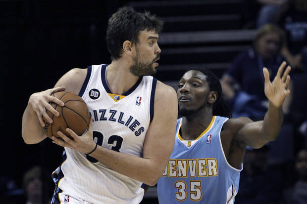 Memphis Grizzlies' Marc Gasol (33), of Spain, is guarded by Denver Nuggets' Kenneth Faried during the first half of an NBA basketball game in Memphis, Tenn., Monday, Nov. 19, 2012. (AP Photo/Danny Johnston)