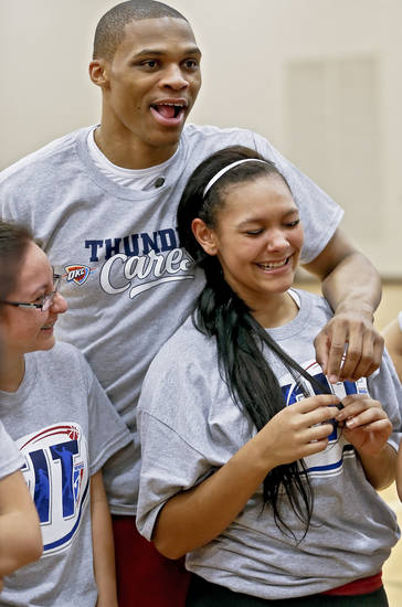 Sabrina Nazaretiz is all smiles as Russell Westbrook helps her with nutrition questions during a visit by the Oklahoma City Thunder to students at U.S. Grant High School to promote physical fitness on Monday, Jan. 28, 2013, in Oklahoma City, Okla.  Photo by Chris Landsberger, The Oklahoman