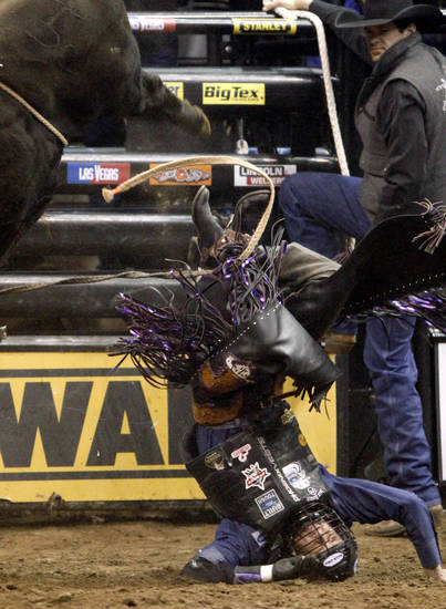 J.B. Mauney lands on his head after falling off Caddy Shack during the Winstar World Casino Invitational PBR tour stop at the Chesapeake Energy Arena on Saturday, Feb. 11, 2012. Photo by Bryan Terry, The Oklahoman