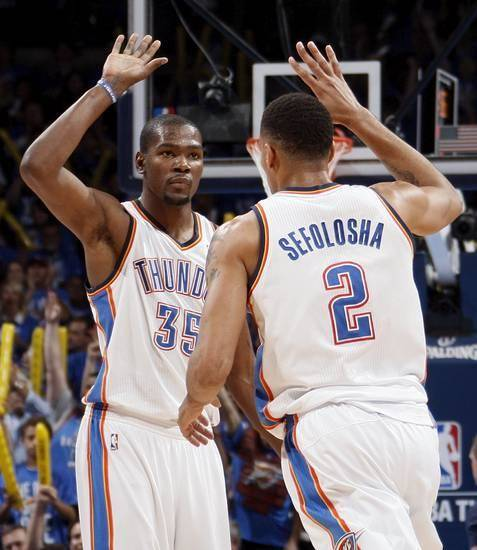Oklahoma City's Kevin Durant (35) and Thabo Sefolosha (2) celebrate during game one of the first round in the NBA playoffs between the Oklahoma City Thunder and the Dallas Mavericks at Chesapeake Energy Arena in Oklahoma City, Saturday, April 28, 2012. Oklahoma City won, 99-98. Photo by Nate Billings, The Oklahoman