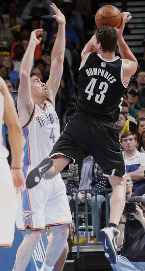 Oklahoma City&#039;s Nick Collison (4) defends on Brooklyn Nets&#039; Kris Humphries (43) during the NBA basketball game between the Oklahoma City Thunder and the Brooklyn Nets at the Chesapeake Energy Arena on Wednesday, Jan. 2, 2013, in Oklahoma City, Okla. Photo by Chris Landsberger, The Oklahoman