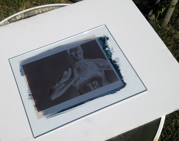A negative of a picture of Steven Adams being contact printed in the sun to make a cyanotype print.