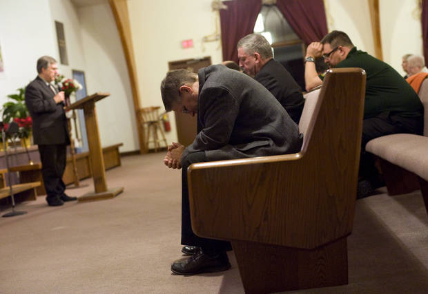 Clergy pray at Mountainside Assembly of God Church in Coal Township, Pa., during an interfaith prayer vigil, Sunday, Dec. 16, 2012, for the victims of Newtown, Conn. Twenty-six people, including 20 children, were killed in Friday's shooting rampage at Sandy Hook Elementary School. (AP Photo/The News-Item, Larry Deklinski) ORG XMIT: PASHA102
