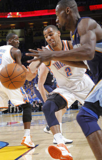 Oklahoma City's Thabo Sefolosha (2) defends on Memphis' Tony Allen (9) during game one of the Western Conference semifinals between the Memphis Grizzlies and the Oklahoma City Thunder in the NBA basketball playoffs at Oklahoma City Arena in Oklahoma City, Sunday, May 1, 2011. Photo by Chris Landsberger, The Oklahoman