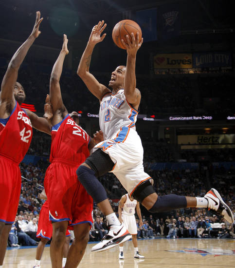 Oklahoma City's Thabo Sefolosha goes to the basket in front of Philadelphia's Elton Brand, left, and Thaddeus Young during the NBA basketball game between the Oklahoma City Thunder and the Philadelphia 76ers at the Oklahoma City Arena on Wednesday, Nov. 10, 2010.   Photo by Bryan Terry, The Oklahoman