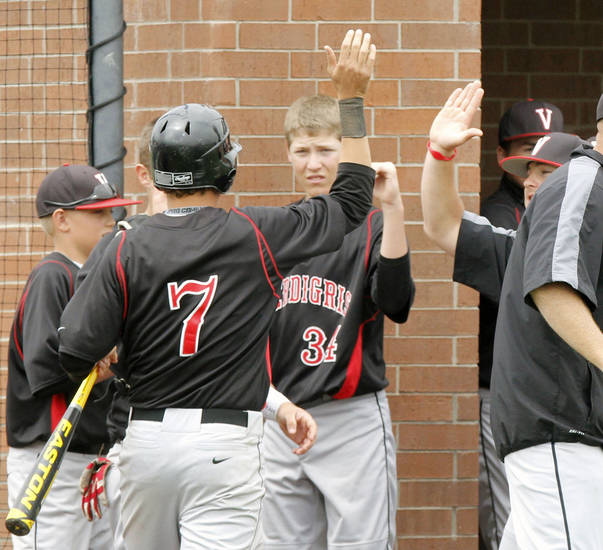 Verdigris' Ryan Skalnik is congratulated by teammates after scoring a run during the Class 3A state baseball tournament between Verdigris and Oklahoma Christian at Deer Creek High School in Oklahoma City, OK, Thursday, May 9, 2013,  By Paul Hellstern, The Oklahoman