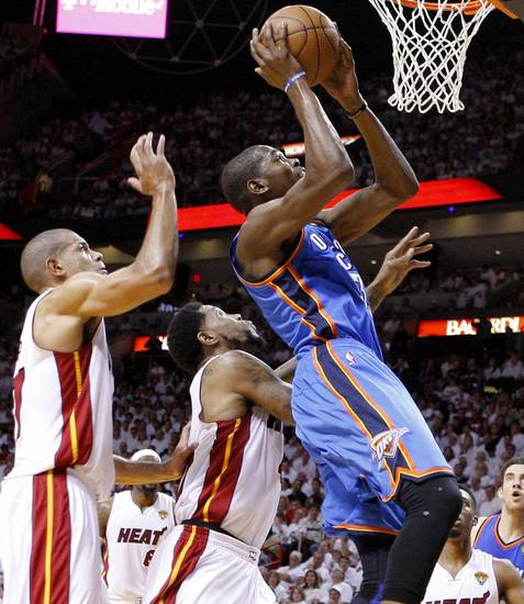 Oklahoma City&#039;s Kevin Durant (35) goes past Miami&#039;s Udonis Haslem, center, and Shane Battier during Game 4 of the NBA Finals between the Oklahoma City Thunder and the Miami Heat at American Airlines Arena, Tuesday, June 19, 2012. Photo by Bryan Terry, The Oklahoman