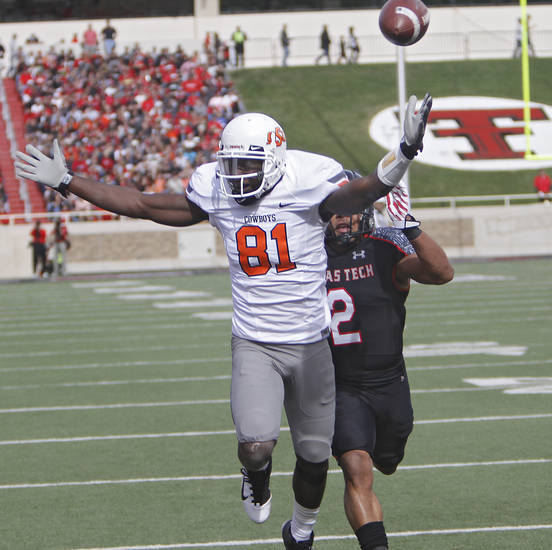 Oklahoma State Cowboys wide receiver Justin Blackmon (81) calls for pass interference on Texas Tech's Cornelius Douglas (2) during the college football game between the Oklahoma State University Cowboys (OSU) and Texas Tech University Red Raiders (TTU) at Jones AT&T Stadium on Saturday, Nov. 12, 2011. in Lubbock, Texas.  Photo by Chris Landsberger, The Oklahoman  ORG XMIT: KOD