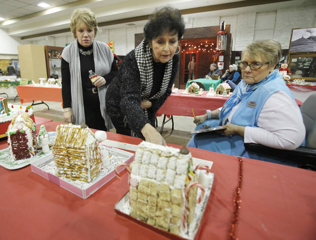 Beth Kerr, left, Carol Smaglinski, center, and Dot Norman judge the fourth annual gingerbread house contest at the Edmond Historical Society and Museum. PHOTOS BY PAUL HELLSTERN, THE OKLAHOMAN