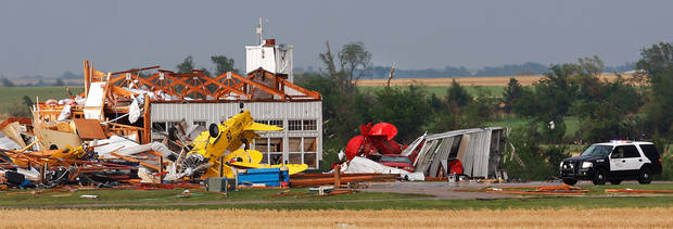 Upended small aircraft are strewn about this destroyed airplane hangar east of SH 74, east of Cashion. after a tornado came through the area Tuesday afternoon,  May 24, 2011,   Photo by Jim Beckel, The Oklahoman