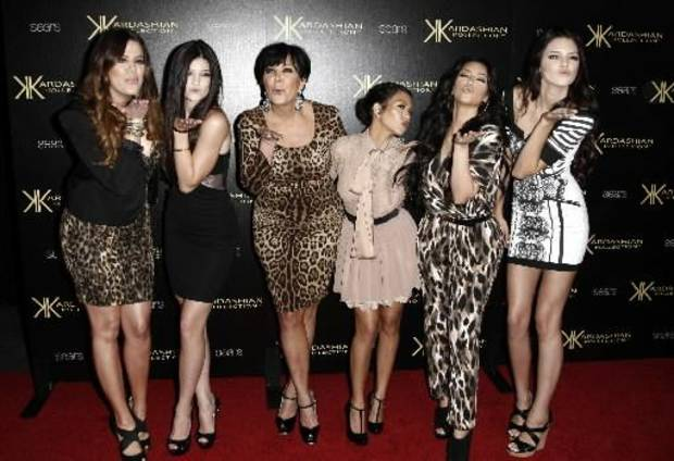 "In this Aug. 17, 2011 file photo, from left, Khloe Kardashian, Kylie Jenner, Kris Jenner, Kourtney Kardashian, Kim Kardashian, and Kendall Jenner arrive at the Kardashian Kollection launch party in Los Angeles. The E! Entertainment network said Tuesday it had reached a deal with its most bankable franchise to make three more seasons of ""Keeping Up With the Kardashians."" (AP Photo/Matt Sayles, file)"